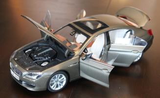 Прикрепленное изображение: 6er-M6(F06)Gran Coupe - speredi sboku vse otkrito.jpg