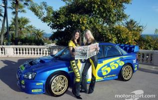 Прикрепленное изображение: wrc-rally-of-monte-carlo-2003-the-lovely-pirelli-girls-during-the-photoshoot-for-the-subar.jpg