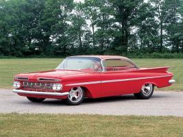 Прикрепленное изображение: 0511cr_01z+1959_chevrolet_impala+two_door_red_body_driver_side_front_view.jpg