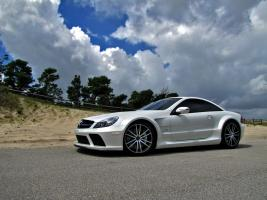 Прикрепленное изображение: 2010-Renntech-Mercedes-Benz-SL65-AMG-Black-Series-Front-Side-View.jpg