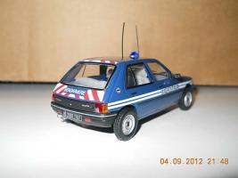 Прикрепленное изображение: Colobox_Peugeot_205_Gendarmerie_Norev~02.jpg