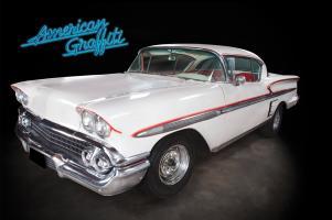 Прикрепленное изображение: american-grafitti-1958-chevy-impala-front-red-graphics.jpg