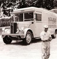 Прикрепленное изображение: At the 1938 Italian Grand Prix Auto Union was using several of these Bussing transporters to efficiently get the cars to the track. It was one car per truck in this case. That's Tazio Nuvolari in the f.jpg