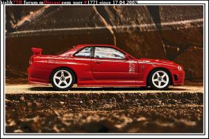 Прикрепленное изображение: AutoArt_Nissan_Skyline_GT_R__R34__NISMO_R_tune.jpg