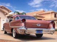 Прикрепленное изображение: Oldsmobile_Golden_Rocket_88_Holiday_Coupe_1957.jpg
