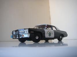 Прикрепленное изображение: Dodge_Monaco_4_door_Sedan_California_Highway_Patrol_1974__ERTL___Autoworld___12_.JPG