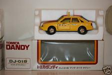 Прикрепленное изображение: Mazda_Capella_CG_Taxi_Tomica_Dandy.jpg